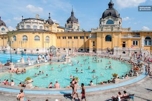 Exterior of the Szechenyi thermal baths Budapest featured in a Budapest party guide.