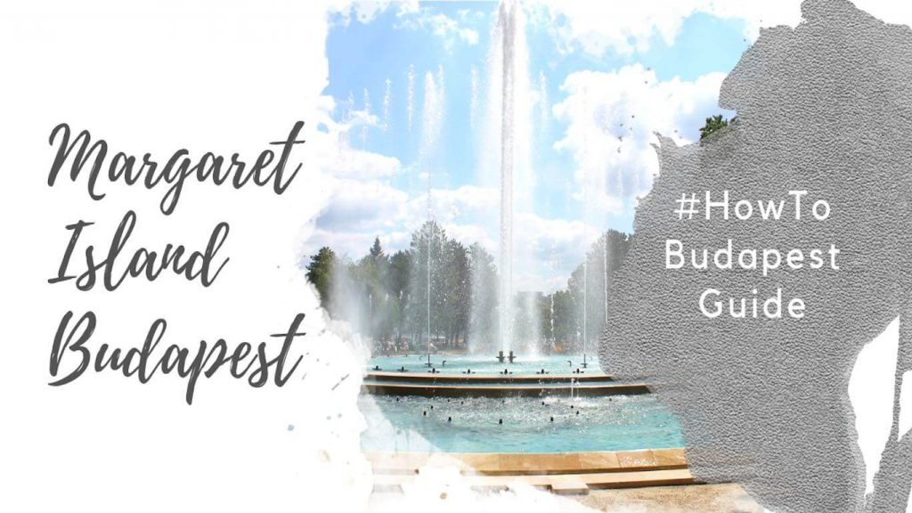 "Feature image for an article about visiting Margaret Island in Budapest. A watercolor foreground has the text ""Margaret Island Budapest"" and ""#howtobudapestguide"". The background image shows a segment of the musical fountain in Margaret Island in the daytime. Water is shooting from the fountain against a blue sky."